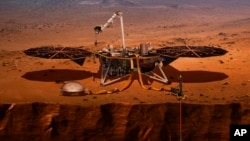 This illustration made available by NASA in 2018 shows the InSight lander drilling into Mars. InSight, short for Interior Exploration using Seismic Investigations, Geodesy and Heat Transport, launched from Vandenberg Air Force Base on Saturday, May 5, 201