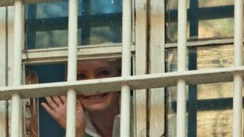 Former Ukrainian Prime Minister Yulia Tymoshenko waves to supporters from a prison window in Kyiv, Ukraine, November 4, 2011.