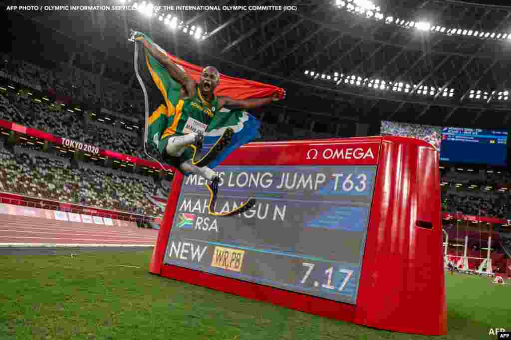 South Africa's Ntando Mahlangu celebrates after winning the men's long jump - T63 final of the Tokyo 2020 Paralympic Games at the Olympic Stadium in Tokyo on August 28, 2021. Philip FONG / AFP
