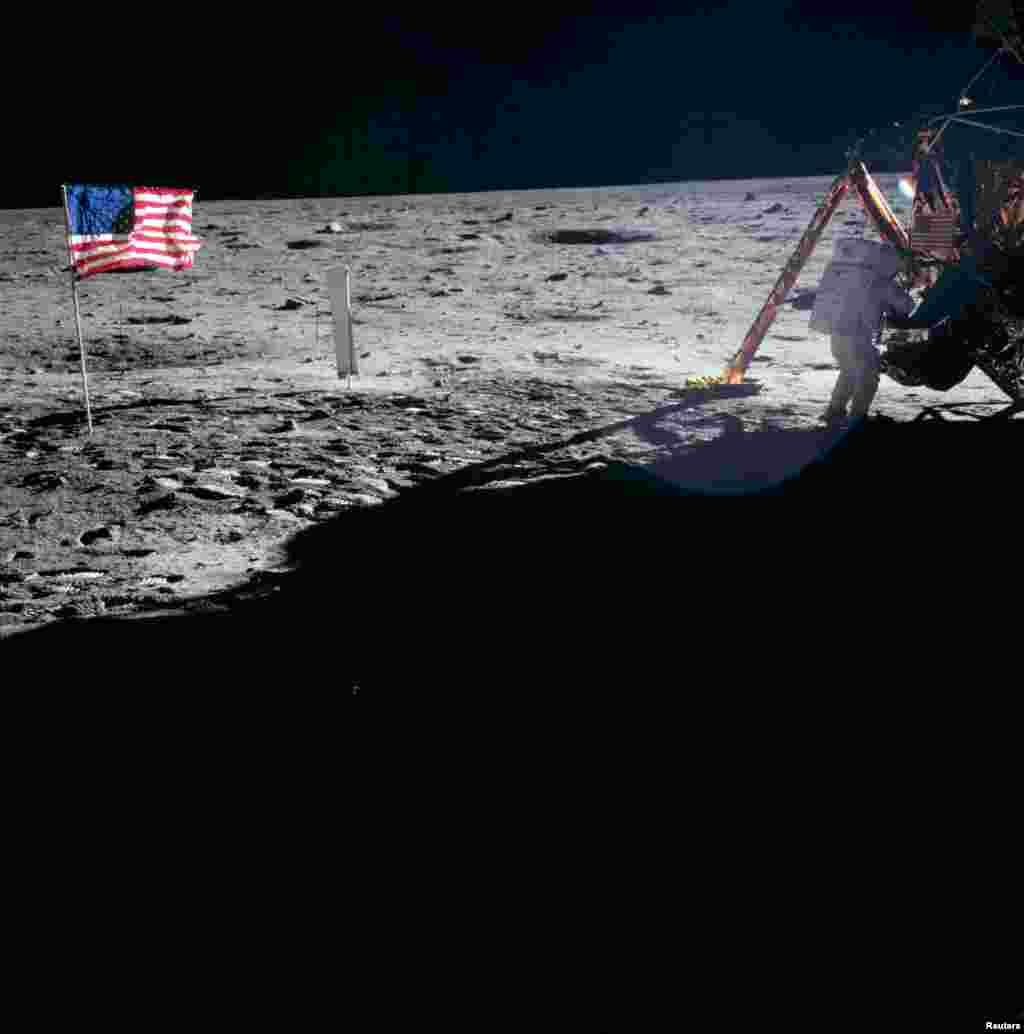 На Луне Армстронг, оснащенный камерой, стал жертвой незавидной участи любого фотографа: сам он почти никогда не появлялся на снимках. За 21 час, что астронавты провели на Луне, был сделан лишь один снимок Армстронга непосредственно с поверхности спутника Земли.  Так как камерой управлял Армстронг, настоящей «звездой» лунных фотосессий стал Базз Олдрин, что, в некоторой мере, компенсировало тот факт, что ему не довелось стать первым человеком на Луне.  Существует большое количество версий, почему первым человеком стал именно Армстронг. НАСА, по одной из версий, не боялось, что почетный статус лунного первопроходца отразится на самомнении Армстронга, известного своей скромностью.  Также, по мнению Дика Слейтона, первый шаг на Луне должен был сделать командир экипажа (кем и являлся Армстронг). Наконец, Армстронгу было банально проще выйти из модуля, так как он располагался ближе к люку.