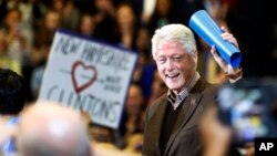 Former President Bill Clinton waves to a cheering crowd as he arrives during a campaign stop for his wife, Democratic presidential candidate Hillary Clinton, Jan. 4, 2016, in Nashua, N.H.