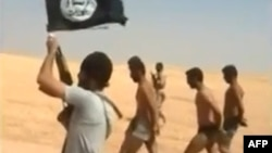 An image grab taken from a video uploaded on social networks, shows young men in underwear being marched barefoot along a desert road before being allegedly executed on Aug. 27, 2014 by Islamic State (IS) militants at an undisclosed location in Syria's Raqa Province.