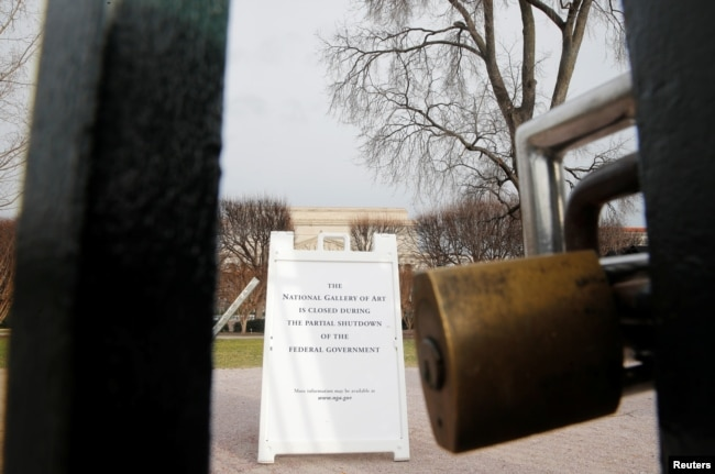 The entrance to the Smithsonian's National Gallery of Art is padlocked as a partial government shutdown continues, in Washington, U.S., Jan. 7, 2019.
