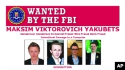This poster provided by the U.S. Department of Justice shows Maxsim Yukabets. Yakubets, 33, is best known as co-leader of a cybergang that calls itself Evil Corp. (U.S. Department of Justice via AP)