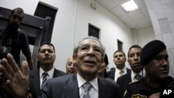 Former Guatemalan dictator Efrain Rios Montt speaks with the media after a judge placed him under house arrest, at the Supreme Court of Justice in Guatemala City January 26, 2012.