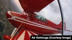 Oshinuga in his aerobatic airplane