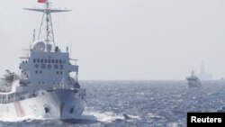 FILE - Ships of Chinese Coast Guard are seen near Chinese oil rig Haiyang Shi You 981 in the South China Sea, about 210 km (130 miles) off shore of Vietnam.