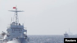 FILE - Ships of Chinese Coast Guard are seen near Chinese oil rig Haiyang Shi You 981 in the South China Sea, about 210 km (130 miles) off shore of Vietnam, May 14, 2014.