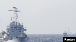 Ships of Chinese Coast Guard near Chinese oil rig Haiyang Shi You 981 in the South China Sea, about 210 km (130 miles) off shore of Vietnam, May 14, 2014.