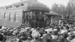 William Howard Taft, center, speaking from the back of a rail car during the presidential campaign of 1908