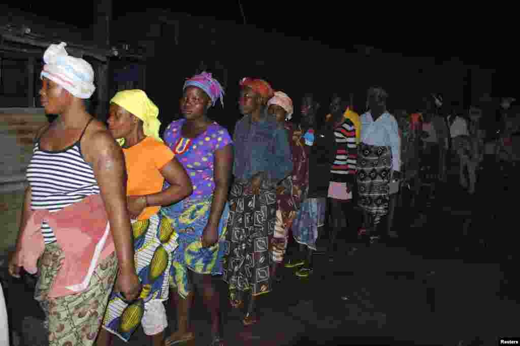 People waiting in line to begin receiving their home disinfectant kits in Monrovia, Liberia, Oct. 20, 2014.
