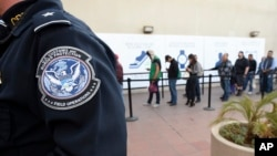 Pedestrians crossing from Mexico into the United States at the Otay Mesa Port of Entry wait in line, Dec. 10, 2015, in San Diego. U.S. Customs and Border Protection is now capturing biometric facial and eye scans of foreigners entering the country at San