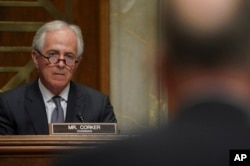 Chairman Sen. Bob Corker, R-Tenn., left, listens during a Senate Foreign Relations Committee hearing on North Korea on Capitol Hill in Washington, Nov. 14, 2017.