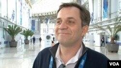 Mikail Demin, Olympic Press Center, Olympic Village, Sochi, Russia, Feb. 16, 2014. (Parke Brewer/VOA)