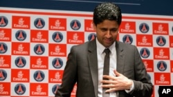 FILE - Paris Saint-Germain soccer club President Nasser Al-Khelaifi arrives to speak to the media during a press conference at Parc des Princes stadium in Paris, France, May 17, 2013.