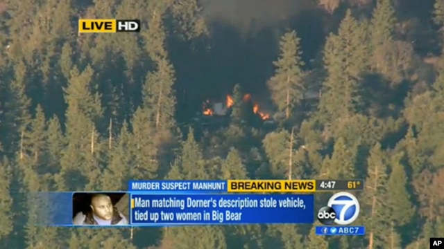 Image taken from video provided by KABC-TV, the cabin in Big Bear, Calif. where ex-Los Angeles police officer Christopher Dorner is believed to be barricaded inside is in flames Tuesday, Feb. 12, 2013.