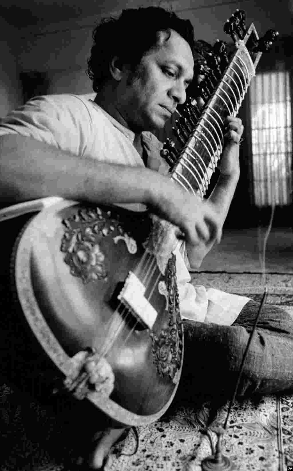 In this 1967 file photo, Ravi Shankar plays his sitar in Los Angeles, California.