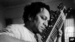 In this 1967 file photo, Ravi Shankar plays his sitar in Los Angeles, California.