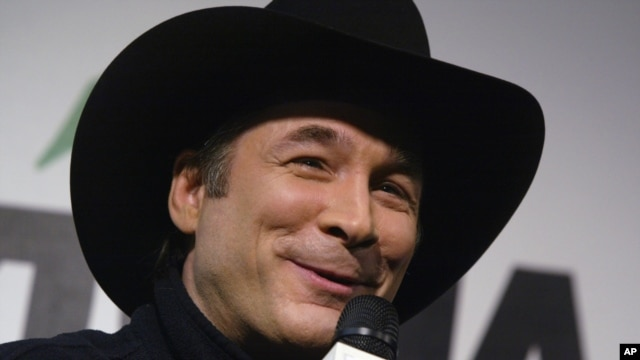 Grammy Award winner Clint Black talks with reporters prior to the start of the Daytona 500 at the Daytona International Speedway in Daytona Beach, Fla., on Feb. 20, 2005.