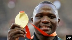 FILE - Javelin gold medalist Kenya's Julius Yego celebrates on the podium at the World Athletics Championships at the Bird's Nest stadium in Beijing, Aug. 27, 2015