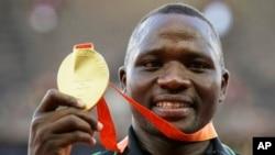 FILE - Javelin gold medalist Kenya's Julius Yego celebrates on the podium at the World Athletics Championships at the Bird's Nest stadium in Beijing, Aug. 27, 2015