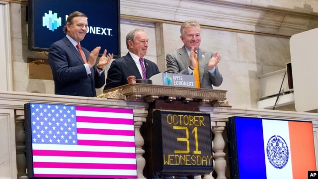 Mayor Michael Bloomberg rings the opening bell at the New York Stock Exchange in New York, October 31, 2012.