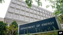 FILE - The building of the Department of Energy is seen in Washington, D.C., May 1, 2015. The Trump transition team has disavowed a survey it sent to the Department requesting the names of people working on climate change in the agency.