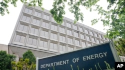 FILE - The Department of Energy is seen in Washington, D.C., May 1, 2015. The Trump transition team has disavowed a survey it sent to the Department survey sent to the U.S. Department of Energy requesting the names of people working on climate change in t