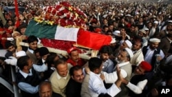 Mourners carry the coffin of senior Pakistani lawmaker Bashir Ahmed Bilour, who died in a suicide attack targeting a meeting of his anti-Taliban Awami National Party, Peshawar, Dec. 23, 2012.
