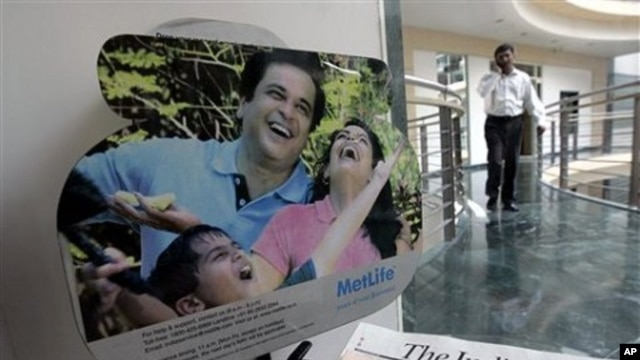A man walks near a display at a Metlife insurance office in Mumbai, India (File Photo)