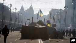 A pro-European Union activist tent camp in the main street of Khreschatyk in Kiev, Ukraine, Tuesday, Dec. 24, 2013.