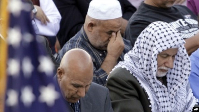 An American flag adorns the stage as worshippers gather for prayer during Eid al-Fitr morning services marking the end of the Muslim holy month of Ramadan at Toyota Park in Bridgeview, Illinois (File)