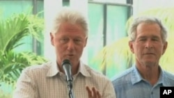 Former presidents Bill Clinton and George Bush speak at donor's conference for Haiti reconstruction aid