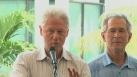 Former presidents Bill Clinton and George Bush speak at donor's conference for Haiti reconstruction aid.