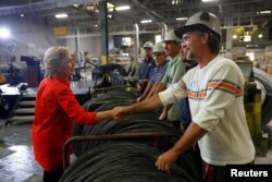 Democratic presidential candidate Hillary Clinton greets workers at Johnstown Wire Technologies in Johnstown, Pennsylvania, July 30, 2016.