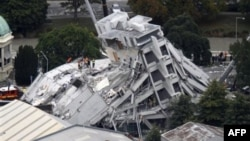 FILE - Rescue workers climb onto the collapsed Pyne Gould Guinness Building in central Christchurch, New Zealand, Feb. 22, 2011.