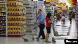 People shop at a Hypermart store in Jakarta.