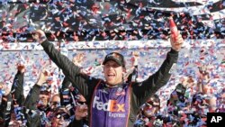 Denny Hamlin celebrates in Victory Lane after winning the NASCAR Daytona 500 Sprint Cup Series auto race at Daytona International Speedway in Daytona Beach, Florida, Sunday, Feb. 21, 2016.