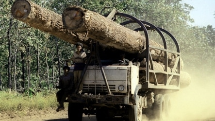 A truck carries logs on a rural road is seen in this July, 2002 photo taken in Preah Vihear province some 245 kilometers (152 miles) north of Phnom Penh, file photo.