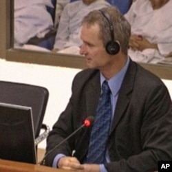 "Rob Hamill, testifying at the tribunal of ""Duch,"" an infamous member of Cambodia's Khmer Rouge regime accused of torture and crimes against humanity."
