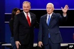 FILE -- Republican vice-presidential nominee Gov. Mike Pence and Democratic vice-presidential nominee Sen. Tim Kaine, left, met at Longwood University in Farmville, Virginia, for their debate Oct. 4, 2016.