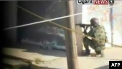 Сотрудник сирийских сил безопасности в городе Хомс