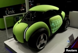 """Toyoda Gosei Co Ltd's personal mobility concept airbag car """"Flesby"""" is displayed at the 44th Tokyo Motor Show in Tokyo, Japan, October 28, 2015."""
