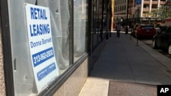 A sign in a window advertises retail leasing in Detroit, September 2, 2021. Downtown businesses that once took for granted an office-worker clientele have had to adapt as offices remain closed and workers stay home. (AP Photo/Mike Householder)