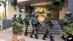 Soldiers from the presidential guard patrol outside the Radisson Blu hotel in Bamako, Mali, in anticipation of the president's visit, Nov. 21, 2015.