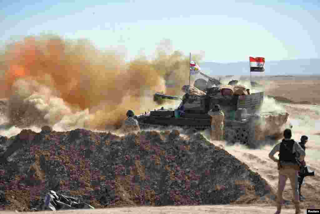 Iraqi Army fires against Islamic State militants on the outskirts of Tal Afar, Aug. 20, 2017.