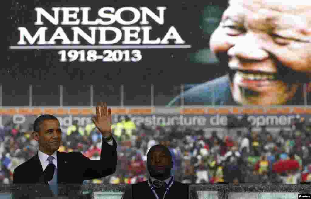 U.S. President Barack Obama addresses the crowd during a memorial service for Nelson Mandela at FNB Stadium in Johannesburg, Dec. 10, 2013.