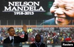 FILE - U.S. President Barack Obama addresses the crowd during a memorial service for Nelson Mandela at FNB Stadium in Johannesburg, Dec. 10, 2013.