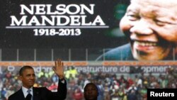 U.S. President Barack Obama addresses the crowd during a memorial service for Nelson Mandela at FNB Stadium in Johannesburg, Dec. 10, 2013.