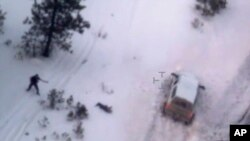 "This photo taken from an FBI video shows Robert ""LaVoy"" Finicum, the figure in the center of the photo, after he was fatally shot by police near Burns, Ore., Jan. 26, 2016."